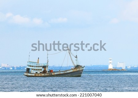 Thai fishing boat used as a vehicle for finding fish in the sea. - stock photo