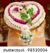 Thai flower heart shaped garland on golden tray with pedestal use for blessed water in Thai wedding ceremony - stock photo