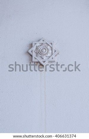 Thai flower ornament on wall  - stock photo