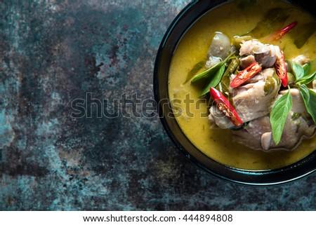 Thai food chicken green curry on dark background. top view - stock photo