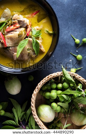 Thai food chicken green curry on dark wooden background. top view - stock photo