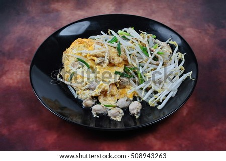 Thai food.,Fried egg and oyster with bean sprouts and shallot as Hoi ...