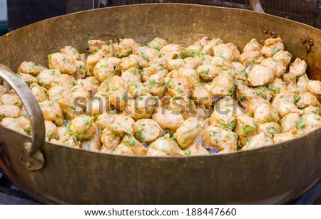 Thai Food fried fish cakes (Tod Mun Pla) in the pan.  - stock photo