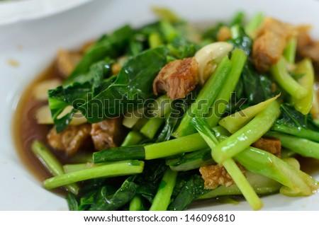 Thai food fried kale with crispy pork - stock photo