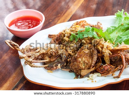 Thai food, fried soft shell crab with garlic and pepper - stock photo