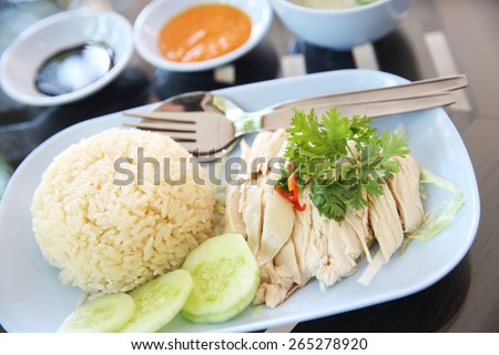 Thai food gourmet steamed chicken with rice , khao mun kai in wood ...