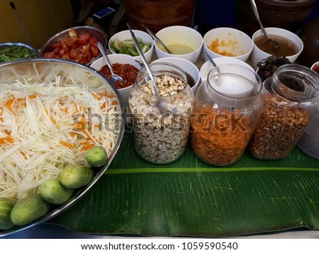 Thai food ingredients green papaya salad stock photo royalty free thai food ingredients for green papaya salad recipe on vendor table at flea marketredded forumfinder Image collections