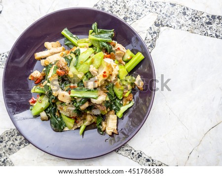 Thai food, kana moo krob.(fried kale mixed crispy pork) - stock photo