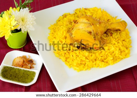 Thai Food (Khao mok kai) : Close up of fragrant yellow rice with ...
