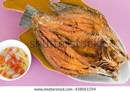 Thai food menu - Oyster sauce over fried striped bass fish (famous thai food) - stock photo
