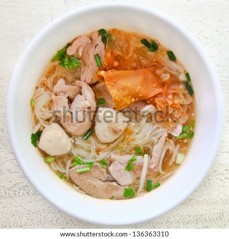 Thai food.noodle soup with fish ball and pork. - stock photo