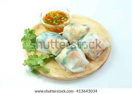 Thai food : Noodles paper wrapped vegetables, dry shrimp, fish, peanut with sweet sauce. - stock photo