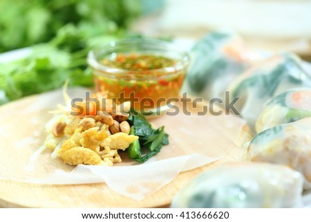 Thai food : Noodles paper wrapped vegetables, dry shrimp, fish, peanut with sweet sauce. Selective focus. - stock photo