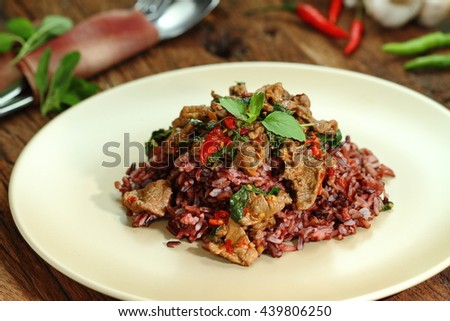Thai food, Pad Ka Phrao, fried meat with chili, garlic and holy basil. eat with rice burry. - stock photo
