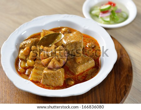 Thai food pork mussaman curry with sauce - stock photo
