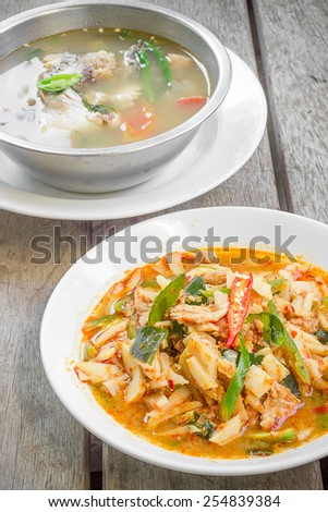 Thai food red curry pig with bamboo shoots and fish soup. - stock photo