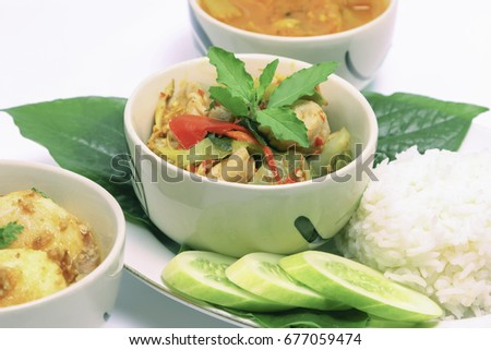 Thai food, spicy fish ball with herb with some rice on white background.