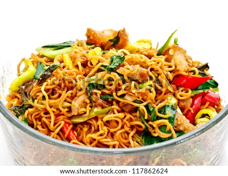 Thai food; spicy fried noodle with pork - stock photo