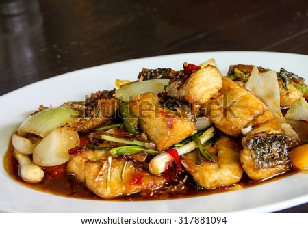 Thai food, stir fried fish with pepper and onion - stock photo