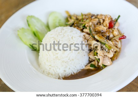 Thai food Thai spicy food, Fried chicken with sweet basil. - stock photo