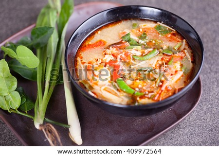 "Thai food ""Tom Yam Koong"" (a classic spicy lemongrass and shrimp soup) - stock photo"