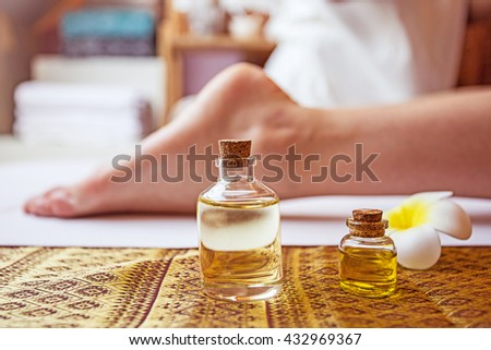 Thai foot massage alternative medicine therapy with Thai herb aroma oil ,background for spa or alternative medical therapy concept.