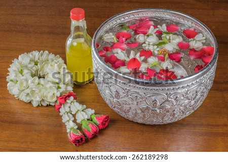 Thai garland Flowers and Water with jasmine and roses corolla in bowl  (Use for Songkran festival in Thailand) - stock photo
