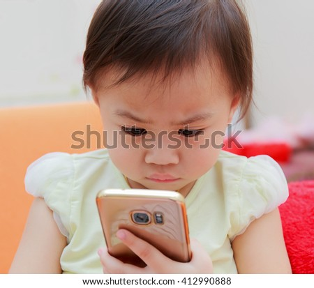 thai girl hands hold smart phone on sofa - stock photo