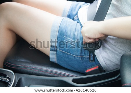 Thai girl sitting in a car seatbelt for safety driving