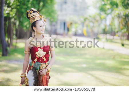 Thai girl with northern style dress in temple, Phayao, Thailand - stock photo