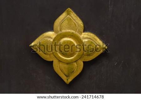 Thai golden decorative flower name Prajumyam is used for door, window and temple decoration. - stock photo