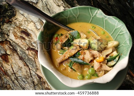 Thai Green pork Curry on a wood background. - stock photo
