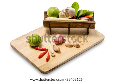 thai herb ingredients food  in bamboo cup and wood on white background - stock photo
