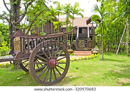 Thai house style and Old farmer wooden cart in Thailand.