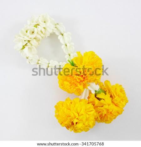 Thai jasmine and marigold garland for Thai tradition. - stock photo