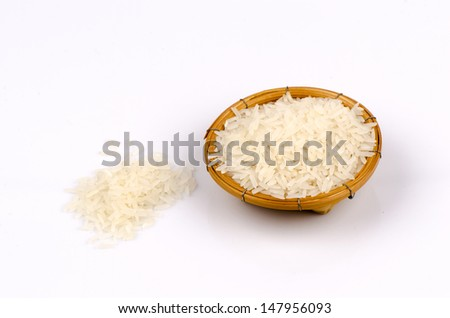 Thai jasmine rice in bamboo basket on a white background.