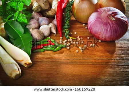 thai kitchen food spice herb  pepper mint lemon grass red onion garlic chilly ginger for cooking original eastern food syle on top wood table  - stock photo