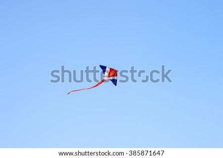 Thai kite in isolated blue sky