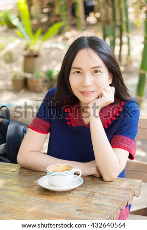 Thai lady in mountain people dress with  coffee cup