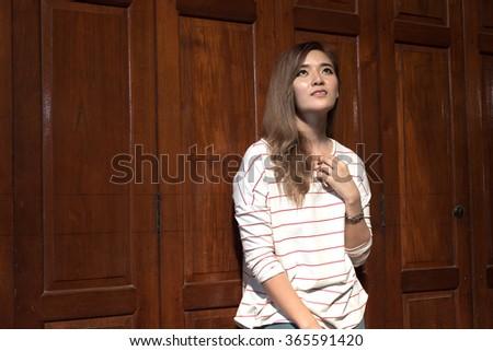 thai lady pray for something, god bless - stock photo