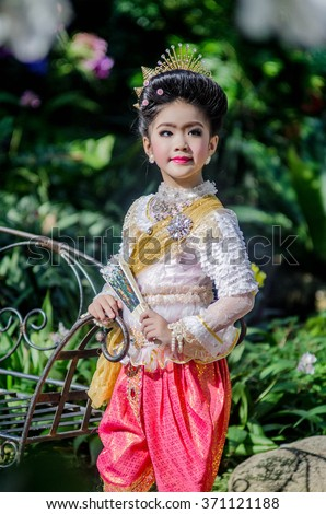Thai little girl dancing with thai style. - stock photo