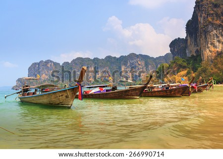 Thai long tail boat and landmark at Railay beach, Krabi, Andaman Sea, South of Thailand