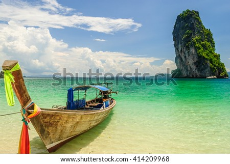 Thai Long Tail Boat Floating Nearby Island With Big Rock Behind