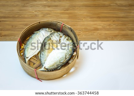 Thai mackerel fish steamed on bamboo basket on bamboo wooden background; Pla-too is name have been called in Thai language.