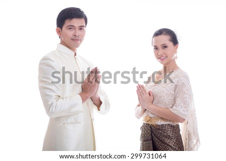 Thai Man and women welcome with traditional Thai suit in Studio - stock photo