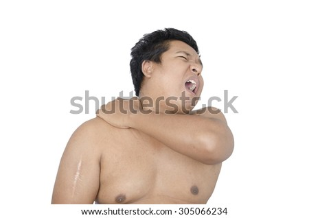 Thai man shoulder pain on white background - stock photo