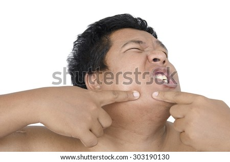 Thai man squeezing pimple on white background