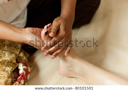 thai massage of young girl - stock photo