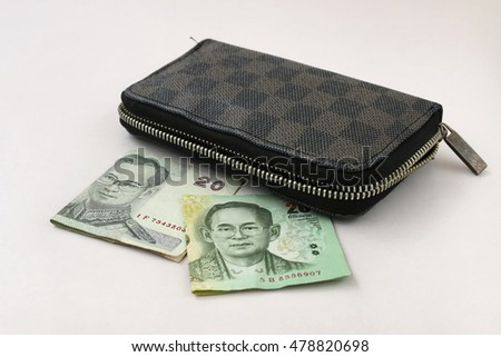 Thai money and Brown leather wallet