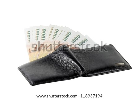 thai money banknotes and black wallet isolated on white background. - stock photo